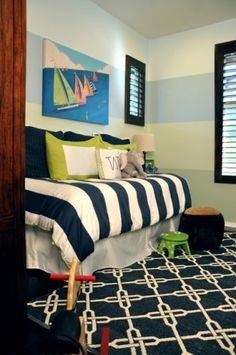 nautical navy room with a navy/white carpet....eclectic kids by Jessica Bennett Interiors