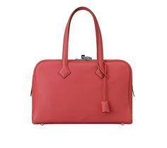 """July 2019 - Charlotte, Dimitri, and the kids were spotted on vacation. Charlotte's bag is probably the """"Victoria"""" bag by Hermès. You can purchase the """"Victoria II Fourre-Tout 35 bag"""" by the brand here. Satchel, Crossbody Bag, Tote Bag, Jaipur, Leather Handbags, Leather Bag, Hermes Online, Boston Bag, Small Leather Goods"""