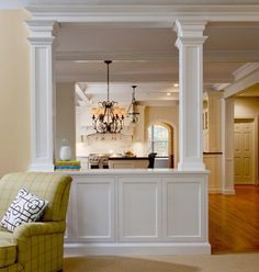 open concept dining room with pillars and partial wall Interior Columns, Interior Exterior, Living Room Paint, Living Room Kitchen, Dining Room, Half Wall Decor, Home Renovation, Home Remodeling, Half Wall Kitchen