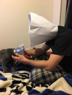 Guy Wears A 'Cone Of Shame' So His Kitten Wouldn't Feel Alone