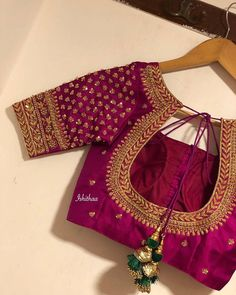 Statement blouses that speak your taste. Gorgeous purple color satin bridal blouse with floral and creeper design hand embellishments . Blouse with short gold jari sleeves. Luxury bridal blouses from Ishithaa Design House. Cutwork Blouse Designs, Wedding Saree Blouse Designs, Simple Blouse Designs, Pattu Saree Blouse Designs, Half Saree Designs, Stylish Blouse Design, Wedding Sarees, Latest Blouse Neck Designs, Choli Blouse Design