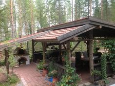 Pizzauuni | pizzaamokkipihalta Backyard Pavilion, Backyard Bar, Outdoor Spaces, Outdoor Living, Outdoor Decor, Rustic Outdoor Kitchens, Garden Structures, Outdoor Structures, Log Shed
