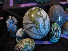Yvonne's Frog egg collection: Ostrich, emu and goose eggs with frogs painted on them.