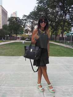 #Lollapalooza 2014: It's no surprise Christina Pacelli's day job is as a fashion stylist. The street style pro, in an Alexander Wang leather shirt and Alaïa skirt, accessorized with a 3.1 Phillip Lim bag, Celine shades, and mint green Topshop shoes.