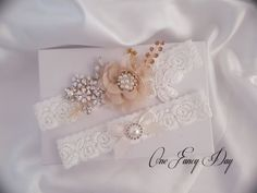 This gorgeous Wedding Garter Set is handmade with rhinestones, pearls and delicate chiffon flower. Assembled to create a uniquely beautiful floral pattern. Matching toss garter is equally beautiful, creating a one-of-a-kind garter set for your special day! Lace: Off White. 1 Wide. CUSTOM CREATE YOUR GARTER: See the flower color chart image. For custom garter, simply leave a note in the note to seller section with the flower colors of your choice for both keepsake and toss garter…