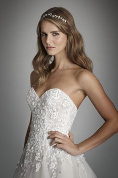 Style 9702  Alvina Valenta bridal gown -Ivory and Reverie pink tulle A-line bridal gown, strapless sweetheart neckline with an embroidered dropped waist bodice beaded with pearl and crystals.
