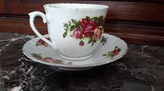 Vintage tea cup & Saucer set, Chinese makers mark. Red & yellow roses. In my collection for about 12 years. https://www.etsy.com/listing/495590574/vintage-tea-cup-saucer-set-made-in-china