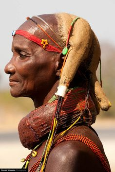 Africa | Portrait of a Mumuhuila woman with beaded and mud headdress, Chibia region, Angola | © Roland Vriesema #beads