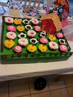 Barnyard cake with cupcake animals