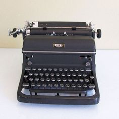 Click clack, look at that! This 1940s large Royal Model KMM typewriter features a very striking black matte finish and glass keys. Put it on display or get cracking on a new novel.