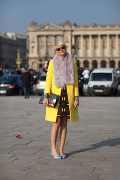 Elisa Nalin's fur stole is chic against bold yellow. Read more: Paris Street Style Fall 2013 - Paris Fashion Week Style Fall 2013 - Harper's BAZAAR