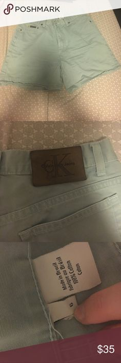 Calvin Klein shorts Never worn! Bought from another posher. They are mint blue jean like shorts. They can fold over to make them shorter or unfolded to be longer. Super cute! Calvin Klein Shorts Jean Shorts