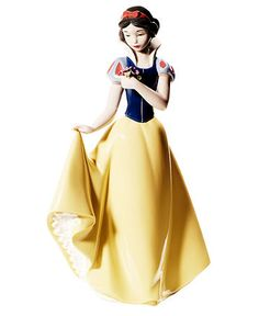 The fairest in the land, this Snow White figurine is nothing short of 12 dwarves. Stopping to smell the flowers, she's epitome of Disney princesses in handmade porcelain from Nao by Lladro. | Porcelai