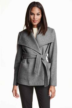 Straight-cut double-breasted jacket in a soft wool blend with wide lapels  and concealed press-studs. Patch pockets at the front, a single back vent  and a ...