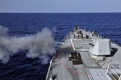 The guided-missile destroyer USS Jason Dunham (DDG 109) fires its MK 455-inch, 62-caliber lightweight deck gun during a live-fire exercise. Jason Dunham is deployed to the U.S. 5th Fleet area of responsibility conducting maritime security operations, theater security cooperation efforts and support missions for Operation Enduring Freedom.