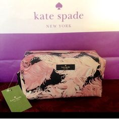 """Kate Spade Cosmetic Pouch Beautiful Kate Spade Medium Davie Cosmetic Pouch in the feather design. Fabric lined interior with a slip pocket on one side.  Zip top closure. 7.5"""" x 4"""" x 4"""" high.  Comes with Kate Spade Care Card.  No Trades kate spade Bags Cosmetic Bags & Cases"""