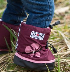 Stonz... best newborn/toddler boots... customized to fit with dual toggle system... hats & mitts too.   http://www.stonzwear.com/default.aspx