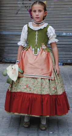 Pintes i Palets: octubre 2012 Folkloric dress of Valencia, Spain called falla or fallera. This regional folk dress is still brought out at festivals & holidays by ladies of the region like the dirndl in Germanic & Bavarian regions. Based on Baroque fashions when Spain achieved it's greatest power and wealth through colonialism, mercantilism, and slavery inflicked abroad. The costumes are nostalic reminder of good times that survived by being easily adaptable to everyday wear until the…