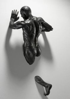 I believe the human body is a work of art.  This artist captures the human physique in it's finest form. These are just a few of many wonderful pieces by Italian sculptor Matteo Pugliese who lives and works in Milan. His bronze sculptures of men, often made from multiple components, appear to be trapped in the vertical space of gallery walls.