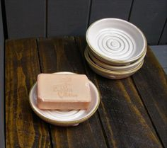 The soap dish is hand thrown in white stoneware clay and finished in white glaze. Pottery Lessons, Pottery Classes, Ceramic Soap Dish, Stoneware Clay, Soap Dishes, Ceramic Pottery, Ceramic Art, Wheel Thrown Pottery, Pottery Making