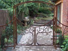 Creative Iron Designs. I love this gate