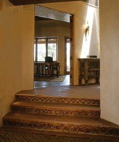 Beautiful David Naylor Interiors custom carved wood stairs. Beautiful rustic design that is perfect for western or southwestern homes. | Stylish Western Home Decorating