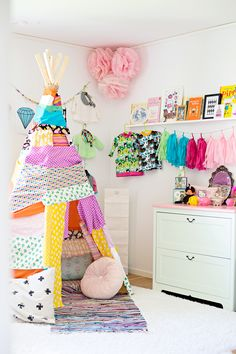 love this tent...so colorful...scarves on the wall-maybe do that with the costumes?