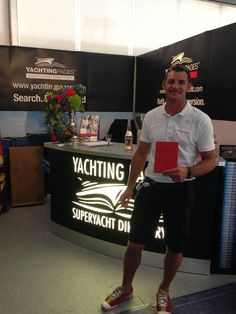 Capt. Daniel receiving the very first copy of Yachting Pages Refit!
