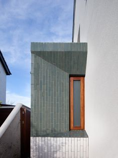 narrow slice side extension, hint of larger extension to rear - green + white tile finish - Greenlea Road, Dublin - GKMP - 2014 Cladding Design, Interior Cladding, Brick Architecture, Interior Architecture, Dublin House, Exterior Tiles, Glazed Brick, Suburban House, Building Exterior