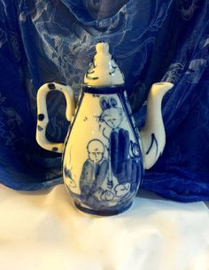 Chinese  teapot  blue and white   Mini Porcelain  Porcelain Handle   5 Inch Height  2 1 Inch Base  Excellent Condition 1 Cup / 2 Small Cups Hand Painted Figural Scene   https://www.etsy.com/listing/211609936/franklin-mint-victoria-and-albert?ref=shop_home_active_22