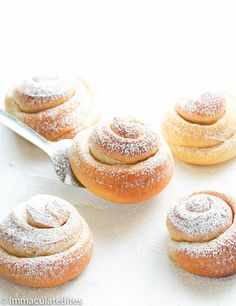 Mallorca Rolls:  Coat rolled out sections of dough with melted butter and egg wash before baking.  Use parchment paper lined muffin tins.  Assume makes approximately 12.
