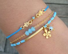 Items similar to Choose your Color - Evil Eye Beaded Gold Bar Bracelet - Blue Seed Bead Flower Charm Friendship Bracelet on Etsy Bracelets Bleus, Jewelry Bracelets, Diamond Bracelets, Bangles, Jewelry Accessories, Jewelry Design, Tassel Bracelet, Chevron Bracelet, Diy Schmuck