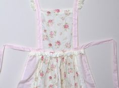 Pink floral cotton apron with lace.  One size fits all. Available from www.lovetheoccasion.com.au