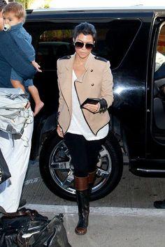 ef09966fe7 Kim and Kourtney Kardashian prepare to depart LAX (Los Angeles  International Airport) with baby