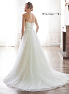 Romantic tulle A-line wedding dress with sweetheart neckline and grosgrain ribbon belt. Enza by Maggie Sottero.