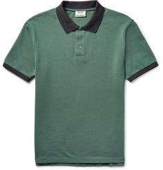 Polo shirts are a perennially useful staple in any off-duty capsule. Acne Studios' 'Kolby' version is crafted from dark grey-green cotton-piqué and has contrasting black trims for a fresh finish. Cut in a slim yet comfortable silhouette, it will look just as smart teamed with denim as it does with chinos.