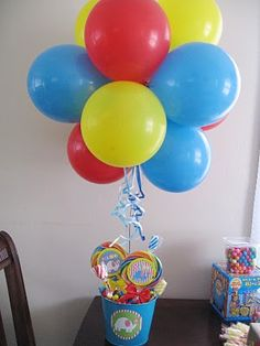 circus decoration but use popcorn container instead of bucket