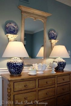 Dining room idea, buffet with two ginger jar lamps, center mirror, and plates on each side. Love this, but definitely want taller, thinner lamps!