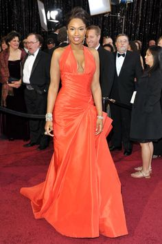 Jennifer Hudson at the 2011 Academy Awards: Jennifer Hudson hit a high note in a bright orange Atelier Versace dress in 2011.