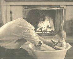 Mary McCartney getting a bath from Paul McCartney
