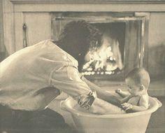 Mary McCartney getting a bath from Paul McCartney