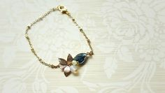 Welcome to 'All about Wed', we sell handmade jewellery and this one here is a gold plated chain with a sapphire birthday stone and a lovely gold plated leaf charm. The bracelet is about 17mm which can be shortened. www.etsy.com/shop/EmelineHui  #jewelry #bridesmaid #bridesmaidgift #style #colourful #creative #gift #giftidea #unique #cute #stylish #bracelet #love #me #girl #bracelet #march #birthday #stone #aquamarine