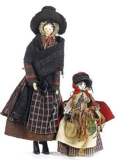 2 Grodnertal painted wooden dolls, circa 1820