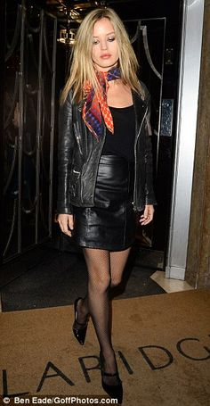 Eyes down: The blonde beauty opted for a racy, black miniskirt which showed off her trim figure