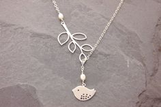 Silver Bird Lariat - bird and branch charms make this lovely lariat. You can wear it short or long - fun and versatile piece! { SIZE & MATERIALS } • Solid .925 sterling silver chain and clasp, quality to last a life-time. The necklace length includes the branch charm and a 2 adjuster.