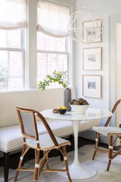 Breakfast nook, settee, neutral dining space, French bistro dining chairs, tulip marble table