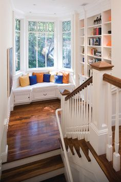 If you have enough room, you can convert the landing into a reading nook. | Case Design/Remodeling