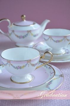 Flower & ribbon garland tea set. Not feeling the pink so much but it's a very sweet design