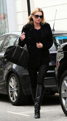 Kate: black boots, black bag, black fur, black shades...