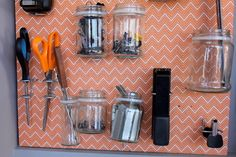 Fabric-covered pegboard -- love this idea.